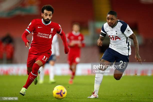 Mohamed Salah of Liverpool runs with the ball under pressure from Steven Bergwijn of Tottenham Hotspur during the Premier League match between...