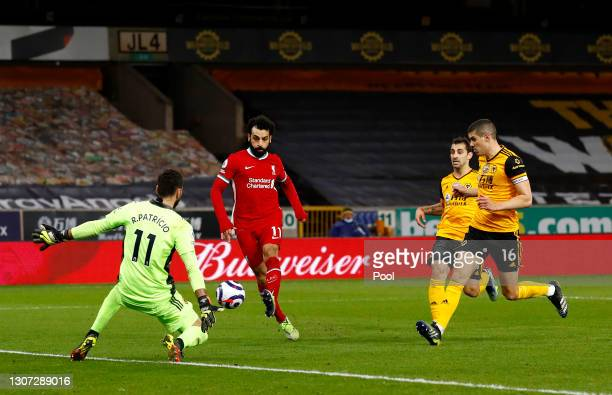 Mohamed Salah of Liverpool scores a goal past Rui Patricio of Wolverhampton Wanderers that is ruled out for offside during the Premier League match...