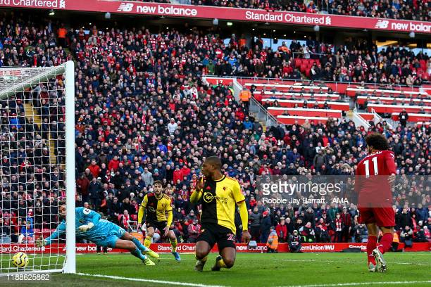 Mohamed Salah of Liverpool scores a goal to make it 20 during the Premier League match between Liverpool FC and Watford FC at Anfield on December 14...