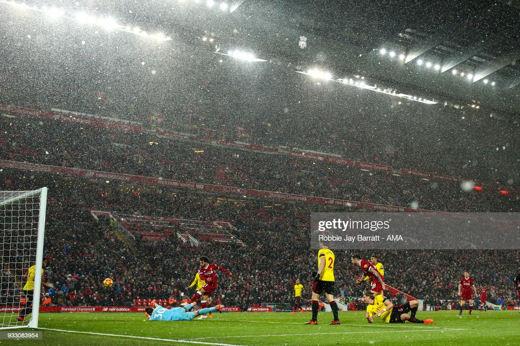 Mohamed Salah of Liverpool scores a goal to make it 5-0 during the Premier League match between Liverpool and Watford at Anfield on March 17, 2018 in Liverpool, England.