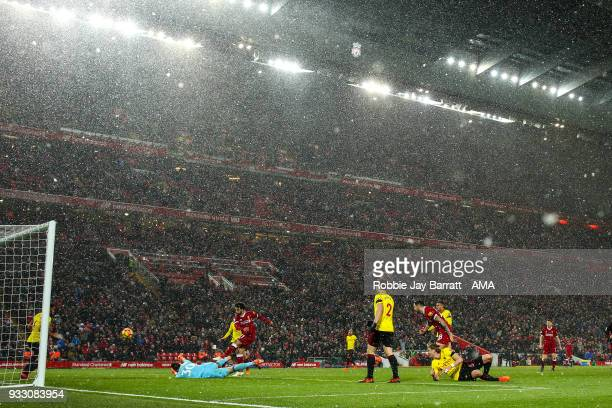 Mohamed Salah of Liverpool scores a goal to make it 50 during the Premier League match between Liverpool and Watford at Anfield on March 17 2018 in...
