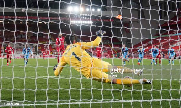 Mohamed Salah of Liverpool scores a penalty for his team's first goal past Lukasz Fabianski of West Ham United during the Premier League match...