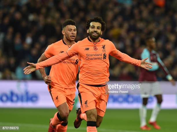Mohamed Salah of Liverpool Scores and celebrates during the Premier League match between West Ham United and Liverpool at London Stadium on November...