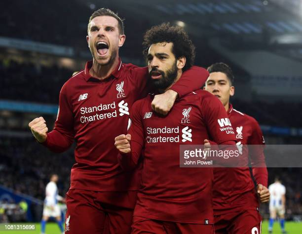Mohamed Salah of Liverpool scores from the penalty spot and celebrates during the Premier League match between Brighton Hove Albion and Liverpool FC...