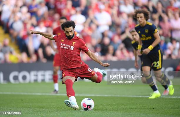 Mohamed Salah of Liverpool scores from the penalty spot during the Premier League match between Liverpool FC and Arsenal FC at Anfield on August 24,...