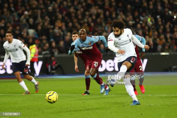 Mohamed Salah of Liverpool scores from the penalty spot during the Premier League match between West Ham United and Liverpool FC at London Stadium on...