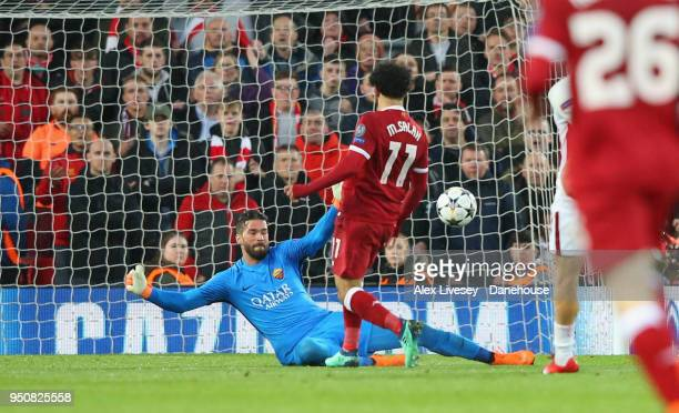 Mohamed Salah of Liverpool scores his second goal during the UEFA Champions League Semi Final First Leg match between Liverpool and AS Roma at...