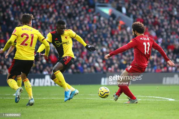 Mohamed Salah of Liverpool scores his sides first goal during the Premier League match between Liverpool FC and Watford FC at Anfield on December 14,...