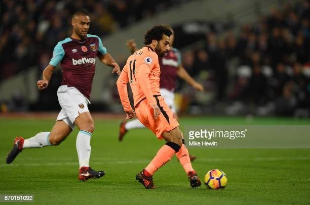 Mohamed Salah of Liverpool scores his sides first goal during the Premier League match between West Ham United and Liverpool at London Stadium on...