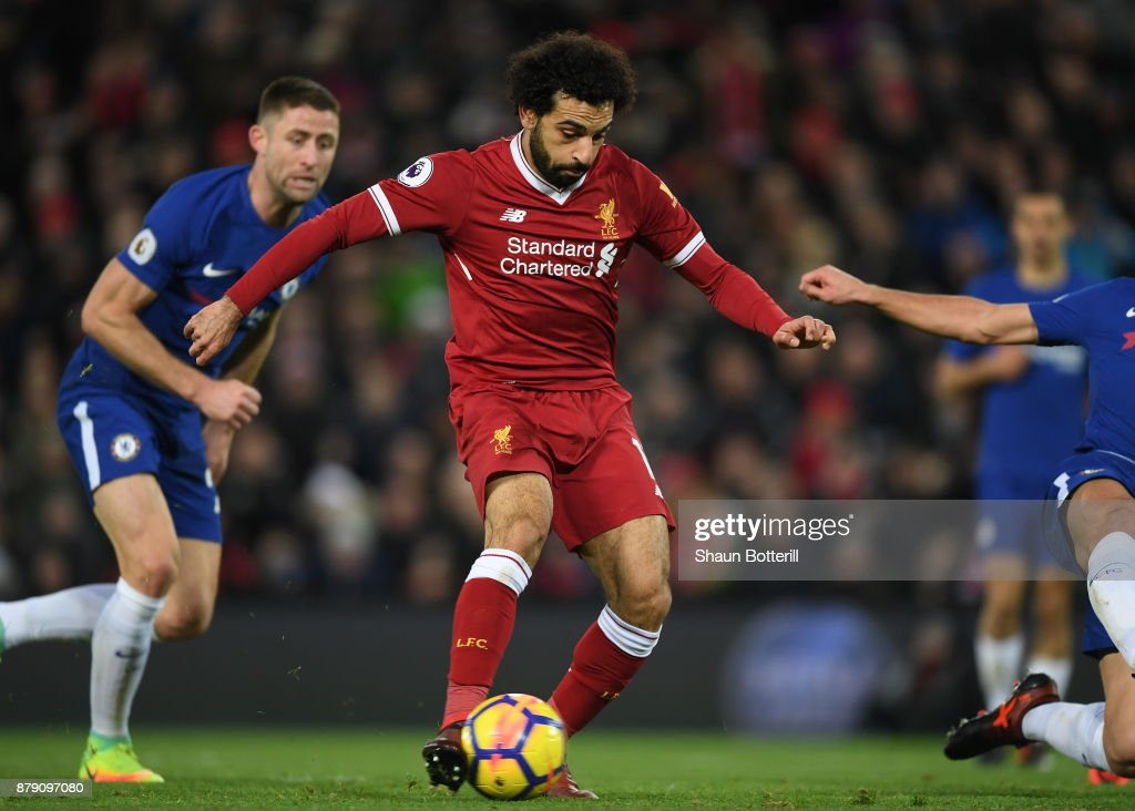 Mohamed Salah of Liverpool scores his sides first goal during the Premier League match between Liverpool and Chelsea at Anfield on November 25, 2017 in Liverpool, England.