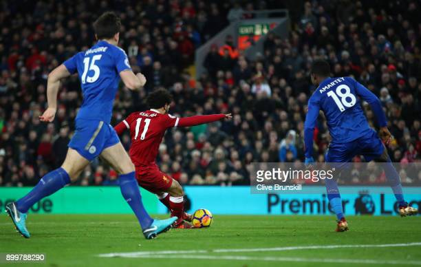 Mohamed Salah of Liverpool scores his sides first goal during the Premier League match between Liverpool and Leicester City at Anfield on December 30...