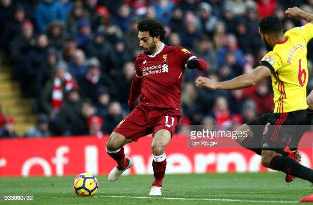 Mohamed Salah of Liverpool scores his sides first goal during the Premier League match between Liverpool and Watford at Anfield on March 17 2018 in...