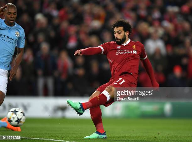Mohamed Salah of Liverpool scores his sides first goal during the UEFA Champions League Quarter Final Leg One match between Liverpool and Manchester...