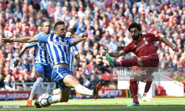 Mohamed Salah of Liverpool scores his sides first goal during the Premier League match between Liverpool and Brighton and Hove Albion at Anfield on...