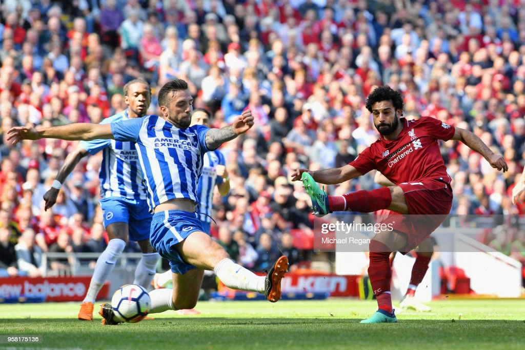 Mohamed Salah of Liverpool scores his sides first goal during the Premier League match between Liverpool and Brighton and Hove Albion at Anfield on May 13, 2018 in Liverpool, England.
