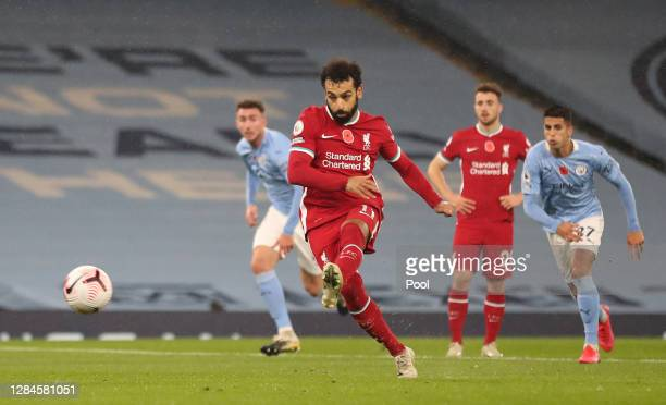 Mohamed Salah of Liverpool scores his sides first goal from the penalty spot during the Premier League match between Manchester City and Liverpool at...