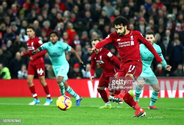 Mohamed Salah of Liverpool scores his sides fourth goal during the Premier League match between Liverpool FC and Arsenal FC at Anfield on December 29...