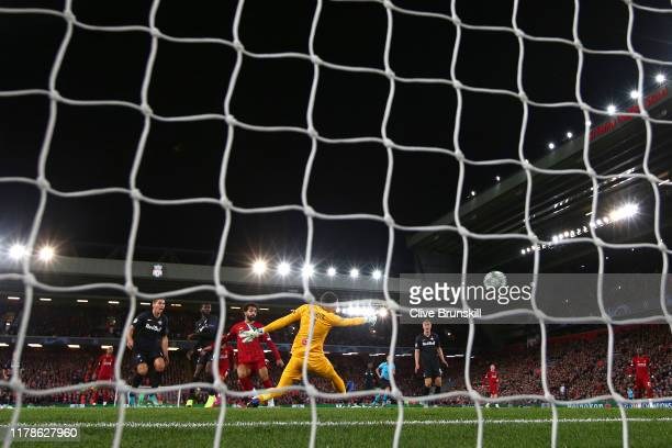 Mohamed Salah of Liverpool scores his sides fourth goal during the UEFA Champions League group E match between Liverpool FC and RB Salzburg at...