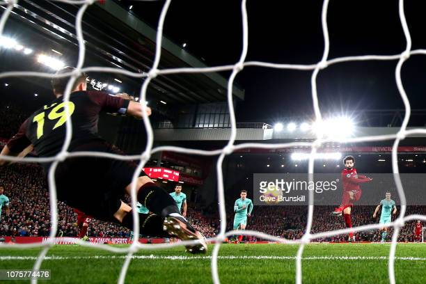 Mohamed Salah of Liverpool scores his sides fourth goal from the penalty spot during the Premier League match between Liverpool FC and Arsenal FC at...