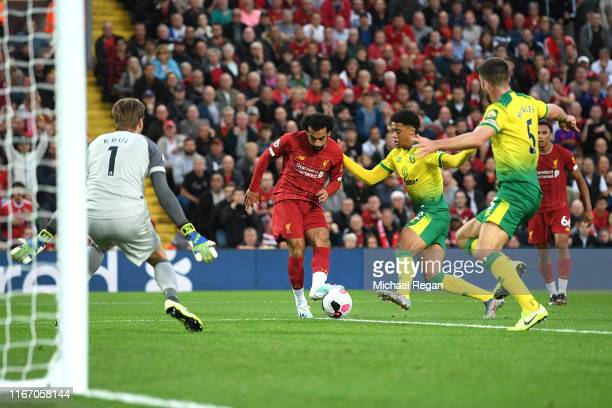 Mohamed Salah of Liverpool scores his sides second goal during the Premier League match between Liverpool FC and Norwich City at Anfield on August...