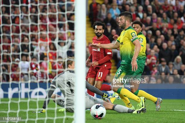 Mohamed Salah of Liverpool scores his sides second goal during the Premier League match between Liverpool FC and Norwich City at Anfield on August 09...