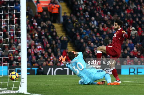 Mohamed Salah of Liverpool scores his side's second goal during the Premier League match between Liverpool and Watford at Anfield on March 17 2018 in...