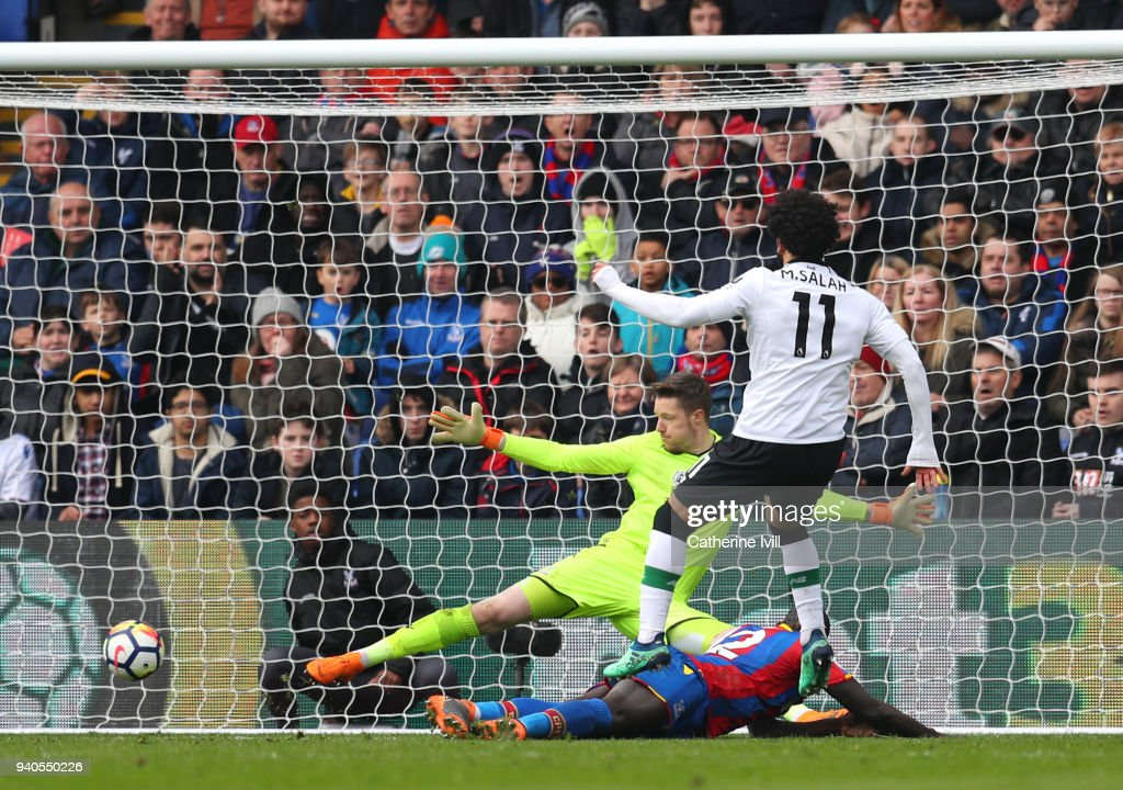 Mohamed Salah of Liverpool scores his sides second goal during the Premier League match between Crystal Palace and Liverpool at Selhurst Park on March 31, 2018 in London, England.