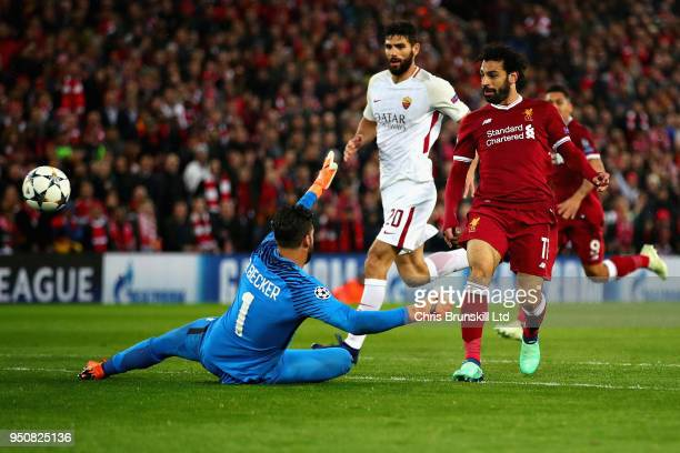 Mohamed Salah of Liverpool scores his sides second goal during the UEFA Champions League Semi Final First Leg match between Liverpool and AS Roma at...