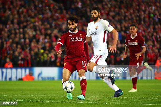 Mohamed Salah of Liverpool scores his side's second goal during the UEFA Champions League Semi Final First Leg match between Liverpool and AS Roma at...