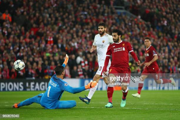 Mohamed Salah of Liverpool scores his sides second goal past Alisson Becker of AS Roma during the UEFA Champions League Semi Final First Leg match...