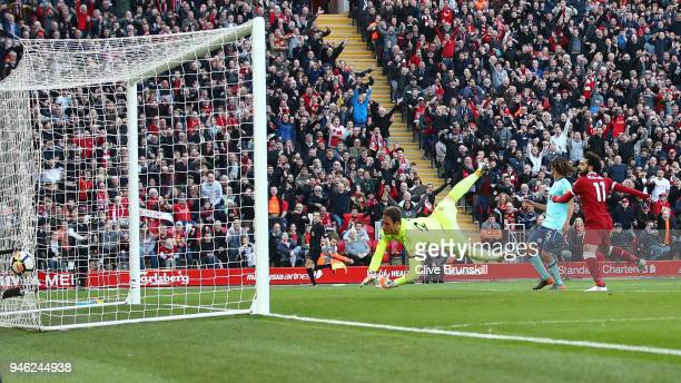 Mohamed Salah of Liverpool scores his sides second goal past Asmir Begovic of AFC Bournemouth during the Premier League match between Liverpool and...