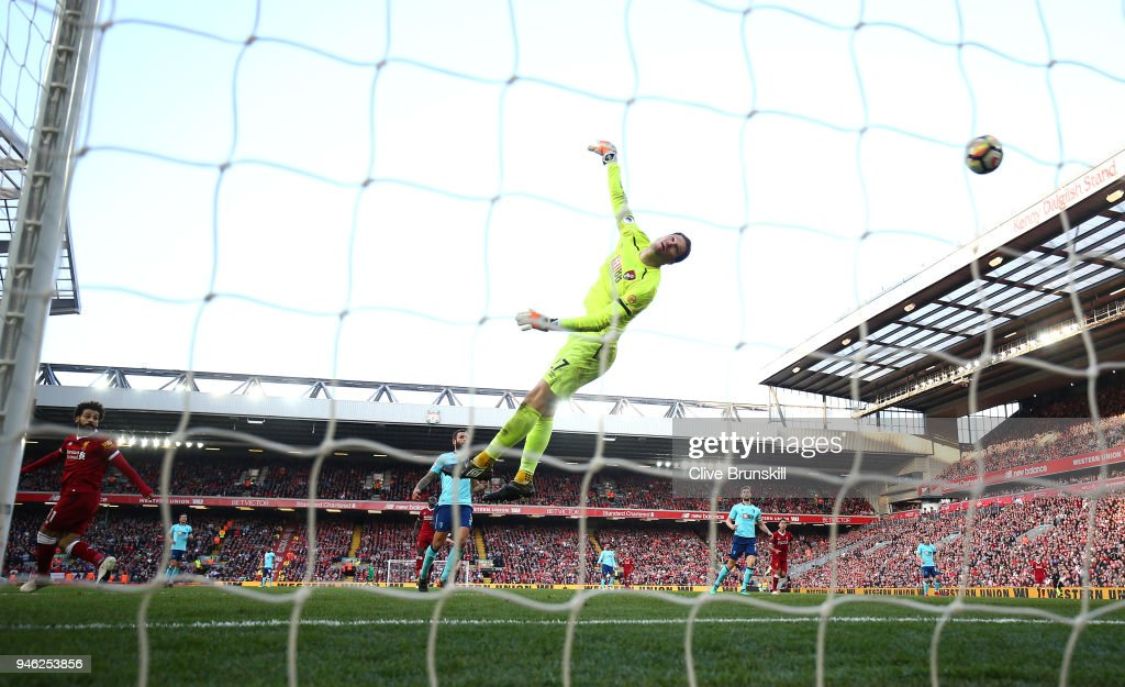 Mohamed Salah of Liverpool scores his sides second goal past Asmir Begovic of AFC Bournemouth during the Premier League match between Liverpool and AFC Bournemouth at Anfield on April 14, 2018 in Liverpool, England.