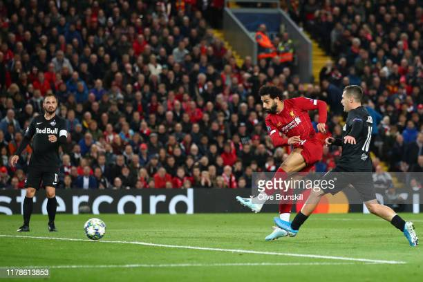 Mohamed Salah of Liverpool scores his sides third goal during the UEFA Champions League group E match between Liverpool FC and RB Salzburg at Anfield...