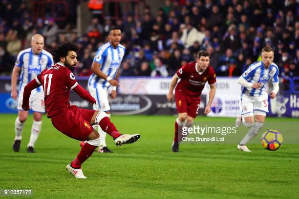 Mohamed Salah of Liverpool scores his side's third goal from the penalty spot during the Premier League match between Huddersfield Town and Liverpool...