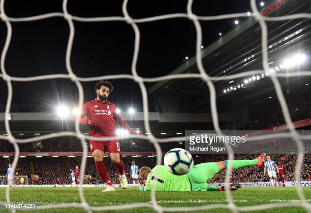 Mohamed Salah of Liverpool scores his team's fifth goal past Jonas Lossl of Huddersfield Town during the Premier League match between Liverpool FC...