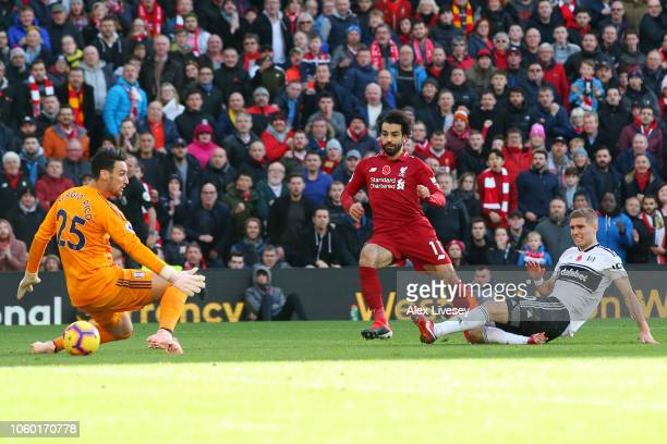 Mohamed Salah of Liverpool scores his team's first goal during the Premier League match between Liverpool FC and Fulham FC at Anfield on November 11...