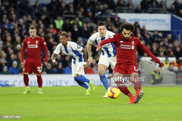 Mohamed Salah of Liverpool scores his team's first goal from the penalty spot during the Premier League match between Brighton & Hove Albion and...