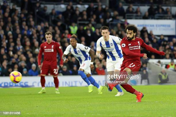 Mohamed Salah of Liverpool scores his team's first goal from the penalty spot during the Premier League match between Brighton Hove Albion and...