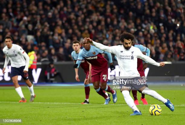 Mohamed Salah of Liverpool scores his team's first goal from the penalty spot during the Premier League match between West Ham United and Liverpool...