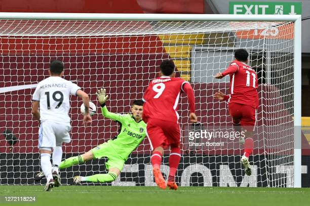 Mohamed Salah of Liverpool scores his team's first goal past Illan Meslier of Leeds United during the Premier League match between Liverpool and...