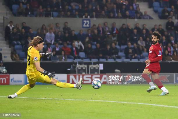 Mohamed Salah of Liverpool scores his team's fourth goal during the UEFA Champions League group E match between KRC Genk and Liverpool FC at Luminus...