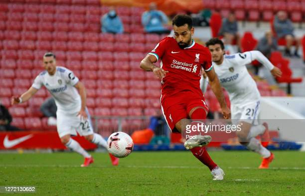 Mohamed Salah of Liverpool scores his team's fourth goal during the Premier League match between Liverpool and Leeds United at Anfield on September...
