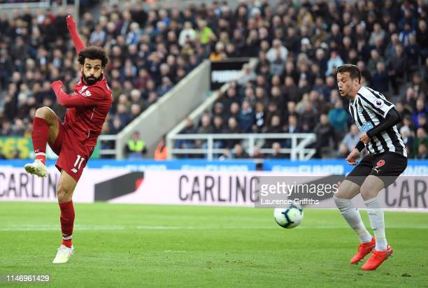 Mohamed Salah of Liverpool scores his team's second goal during the Premier League match between Newcastle United and Liverpool FC at St James Park...