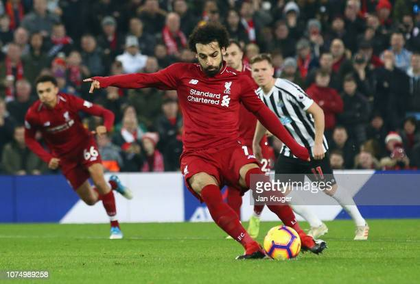 Mohamed Salah of Liverpool scores his team's second goal from a penalty during the Premier League match between Liverpool FC and Newcastle United at...
