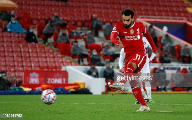 Mohamed Salah of Liverpool scores his team's second goal from the penalty spot during the UEFA Champions League Group D stage match between Liverpool...