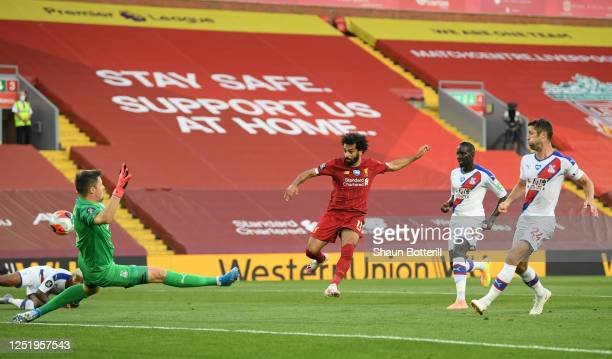 Mohamed Salah of Liverpool scores his teams second goal past Crystal Palace goalkeeper Wayne Hennessey during the Premier League match between...