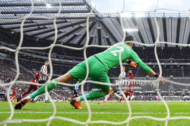 Mohamed Salah of Liverpool scores his team's second goal past Martin Dubravka of Newcastle United during the Premier League match between Newcastle...