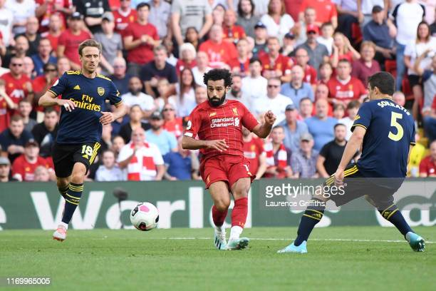 Mohamed Salah of Liverpool scores his team's third goal during the Premier League match between Liverpool FC and Arsenal FC at Anfield on August 24...
