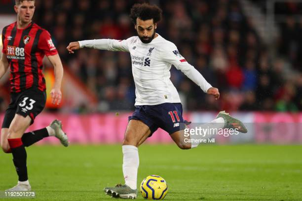 Mohamed Salah of Liverpool scores his team's third goal during the Premier League match between AFC Bournemouth and Liverpool FC at Vitality Stadium...