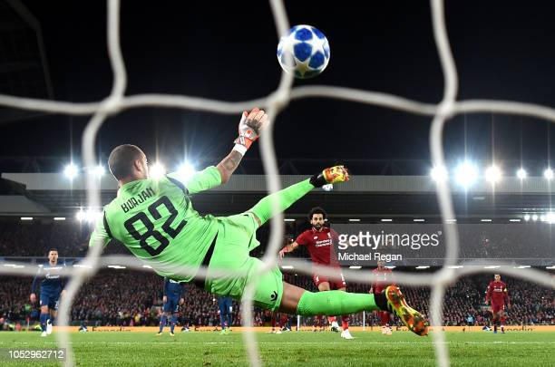 Mohamed Salah of Liverpool scores his team's third goal from a penalty during the Group C match of the UEFA Champions League between Liverpool and FK...